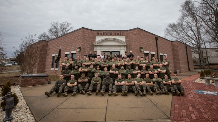 U.S. Marines pose for a photo following the Force Fitness Instructor (FFI) Course culminating event at The Basic School, Marine Corps Base Quantico, Va., February 12, 2018. The FFI course is made up of physical training, classroom instruction and practical application to provide the students with a holistic approach to fitness. Upon completion, the Marines will serve as unit FFIs, capable of designing individual and unit-level holistic fitness programs.