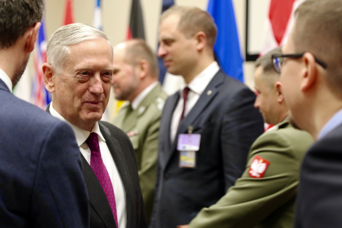 Defense Secretary James N. Mattis speaks with members of the Polish defense minister's delegation.