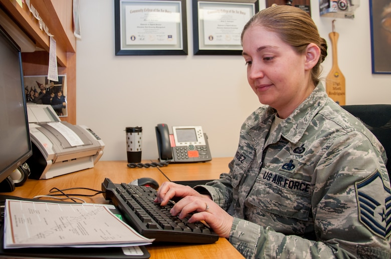 Master Sgt. Misti Rodriguez, Academic Coding Branch superintendent, inputs a transcript into the Air Force Military Personnel Data System to update an officer's record. Two Airmen at the Coding Branch, including Rodriguez, update more than 1,000 transcripts a month in support of some 130,000 total force Air Force officers.  (U.S. Air Force photo/John Harrington)