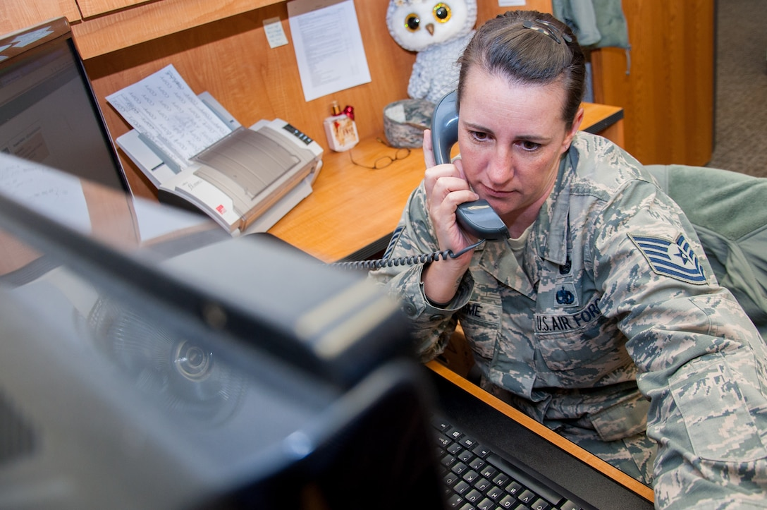 Tech Sgt. Jennifer Warehime, Academic Coding Branch noncommissioned officer-in-charge, provides phone support for an officer attempting to update his academic record. Two Airmen at the Coding Branch, including Warehime, update more than 1,000 transcripts a month in support of some 130,000 total force Air Force officers.  (U.S. Air Force photo/John Harrington) (U.S. Air Force photo/John Harrington)