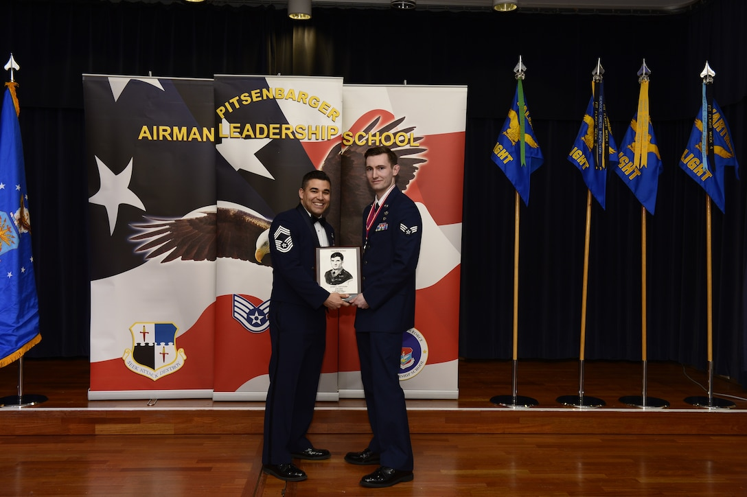 U.S. Air Force Senior Airman Alex Johnson, 52nd Civil Engineer Squadron explosive ordnance disposal journeyman, receives the John L. Levitow award during the Pitsenbarger Airman Leadership School 18-B graduation at Club Eifel on Spangdahlem Air Base, Germany, Feb. 8, 2018. The Levitow award is the highest honor given to the student who displays excellence in all categories of ALS.