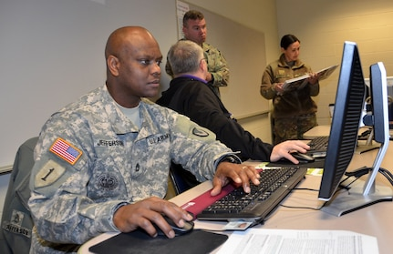 Sgt. 1st Class La Chad Jefferson provides contracting support during a humanitarian assistance disaster relief exercise Feb. 8 at Joint Base San Antonio-Camp Bullis. Jefferson is a contracting officer with the 410th Contracting Support Brigade at JBSA-Fort Sam Houston.