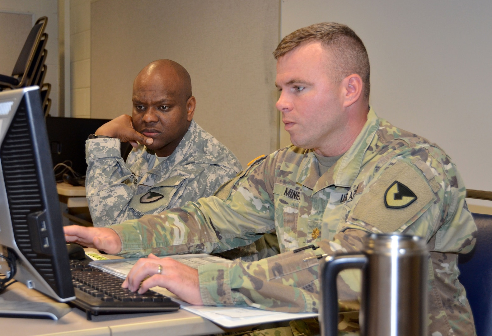 Maj. Keith Miner (right) provides contracting support as Sgt. 1st Class La Chad Jefferson (left) looks on during a humanitarian assistance disaster relief exercise Feb. 8 at Joint Base San Antonio-Camp Bullis. Miner and Jefferson are contracting officers with the 410th Contracting Support Brigade at JBSA-Fort Sam Houston.