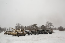 Reserve Marines with Company F, 4th Tank Battalion, 4th Marine Division, stage their vehicles on training day five of exercise Winter Break 2018, aboard Camp Grayling, Michigan, Feb. 11, 2018. During Winter Break 18, Fox Co. took part in platoon and company operations that increased their operational capacity in single degree temperatures and snow covered terrain.