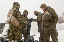 Reserve Marines with Company F, 4th Tank Battalion, 4th Marine Division, disassemble heating units from their arctic tents on training day five of exercise Winter Break 2018, aboard Camp Grayling, Michigan, Feb. 11, 2018. Fox Co., 4th Tank Bn., conducted exercise Winter Break 18 to take advantage of Camp Grayling's frozen, wintery climate and test their offensive, defensive and maneuver capabilities in any austere cold weather environment.