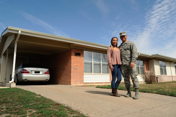 Airman 1st Class Aaron Vang and spouse, Celina Vang, pose in front of their residence at Laughlin Air Force Base, Feb. 7, 2017. Laughlin Family Housing has recently reached 99 percent occupancy and are determined to deliver the best customer service to residents.