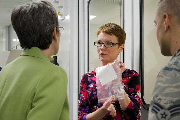 Dr. Julie Gostic, a nuclear evaluator for the Materials Technology Directorate at the Air Force Technical Applications Center, displays an environmental sample to Secretary of the Air Force Heather Wilson (left) during the secretary's visit to the nuclear treaty monitoring center at Patrick AFB, Fla., Feb. 8, 2018. (U.S. Air Force photo by Susan A. Romano)