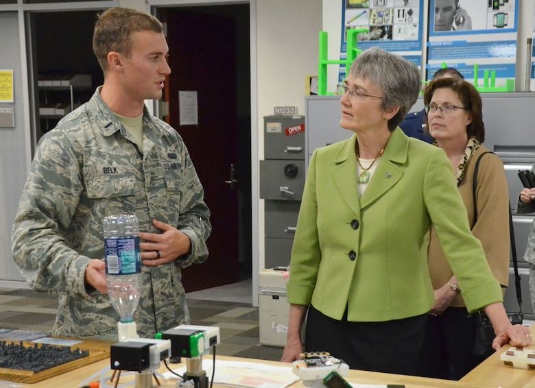 First Lt. Drew Belk, Innovation Lab chief at the Air Force Technical Applications Center, Patrick AFB, Fla., discusses ongoing innovation projects with Secretary of the Air Force Heather Wilson during her visit to the Department of Defense's sole nuclear treaty monitoring center.  Wilson was in town to speak at AFTAC's annual Women in Science and Engineering Symposium Feb. 8, 2018.  (U.S. Air Force photo by William M. Donelson)