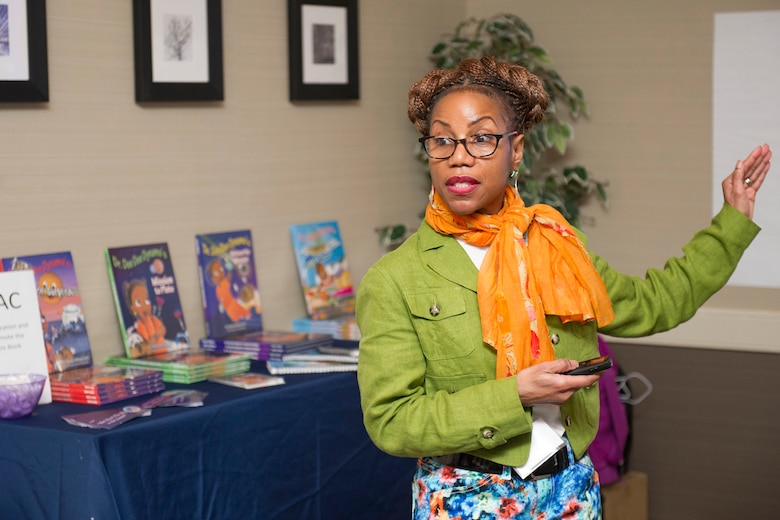 "Dr. Oneeka Williams, a urologic surgeon at St. Elizabeth's Medical Center and assistant clinical professor at Tufts Medical School, briefs attendees at the 2018 Women in Science and Engineering Symposium hosted by the Air Force Technical Applications Center, Patrick AFB, Fla., Feb. 8, 2018.  Williams discussed the importance of speaking frequently to both children and adults about STEM, and encouraged girls, especially those of color, that ""not even the sky is the limit!""   (U.S. Air Force photo by Phillip C. Sunkel IV)"