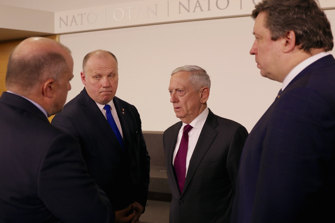 Defense Secretary James N. Mattis speaks with other defense officials in Brussels.