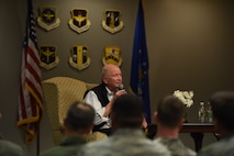 Retired Gen. Duncan McNabb sits on stage and answers a question