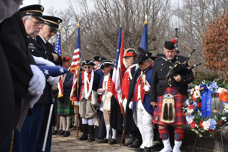 Soldiers and service members past and present, along with citizens in 18th century uniforms and attire, present flags and wreaths during a ceremony honoring the 245th birthday of our 9th President, William Henry Harrison, Feb. 9, in North Bend, Ohio.