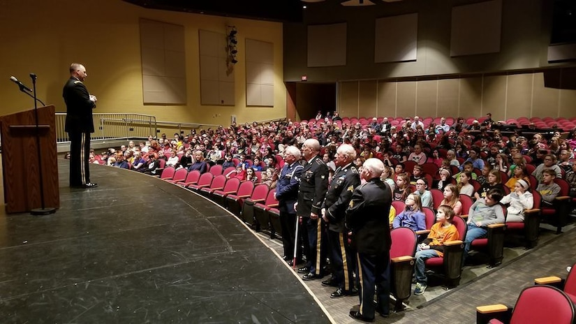 Major Gen. Patrick Reinert, 88th Readiness Division commanding general, visits Three Rivers Educational Campus and speaks with students from Taylor Middle School following a ceremony honoring the 245th birthday of our 9th President, William Henry Harrison, Feb. 9, in North Bend, Ohio.
