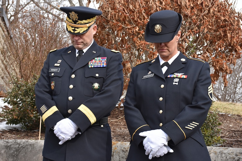 Major Gen. Patrick Reinert, 88th Readiness Division commanding general, and Staff Sgt. Jill Spencer, 88th RD executive assistant, bow their heads during a ceremony honoring the 245th birthday of our 9th President, William Henry Harrison, Feb. 9, in North Bend, Ohio.
