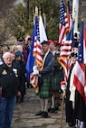 Local citizens and The Sons and Daughters of the American Revolution stand along with students from the Three Rivers Educational Campus during a ceremony honoring the 245th birthday of our 9th President, William Henry Harrison, Feb. 9, in North Bend, Ohio.