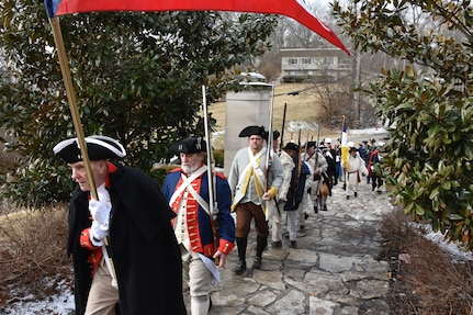 A procession of Soldiers and service members past and present, along with relatives, local officials and citizens in 18th century uniforms and attire, march through the Village of North Bend, Ohio, to the tomb of William Henry Harrison, Feb. 9, to honor our 9th President's 245th birthday.