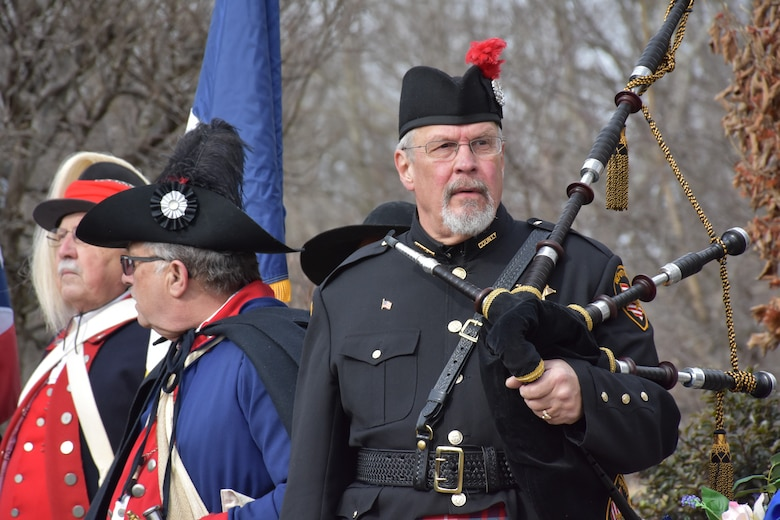 A bagpipe player prepares to play a ceremony honoring the 245th birthday of our 9th President, William Henry Harrison, Feb. 9, in North Bend, Ohio.