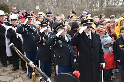 Local officials and retired U.S. Army Soldiers salute for a ceremony honoring the 245th birthday of our 9th President, William Henry Harrison, Feb. 9, in North Bend, Ohio.