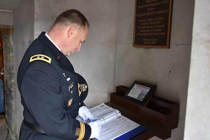 Major Gen. Patrick Reinert, 88th Readiness Division commanding general, signs his name in the guest book at the tomb of our 9th President, William Henry Harrison, Feb. 9, in North Bend, Ohio.
