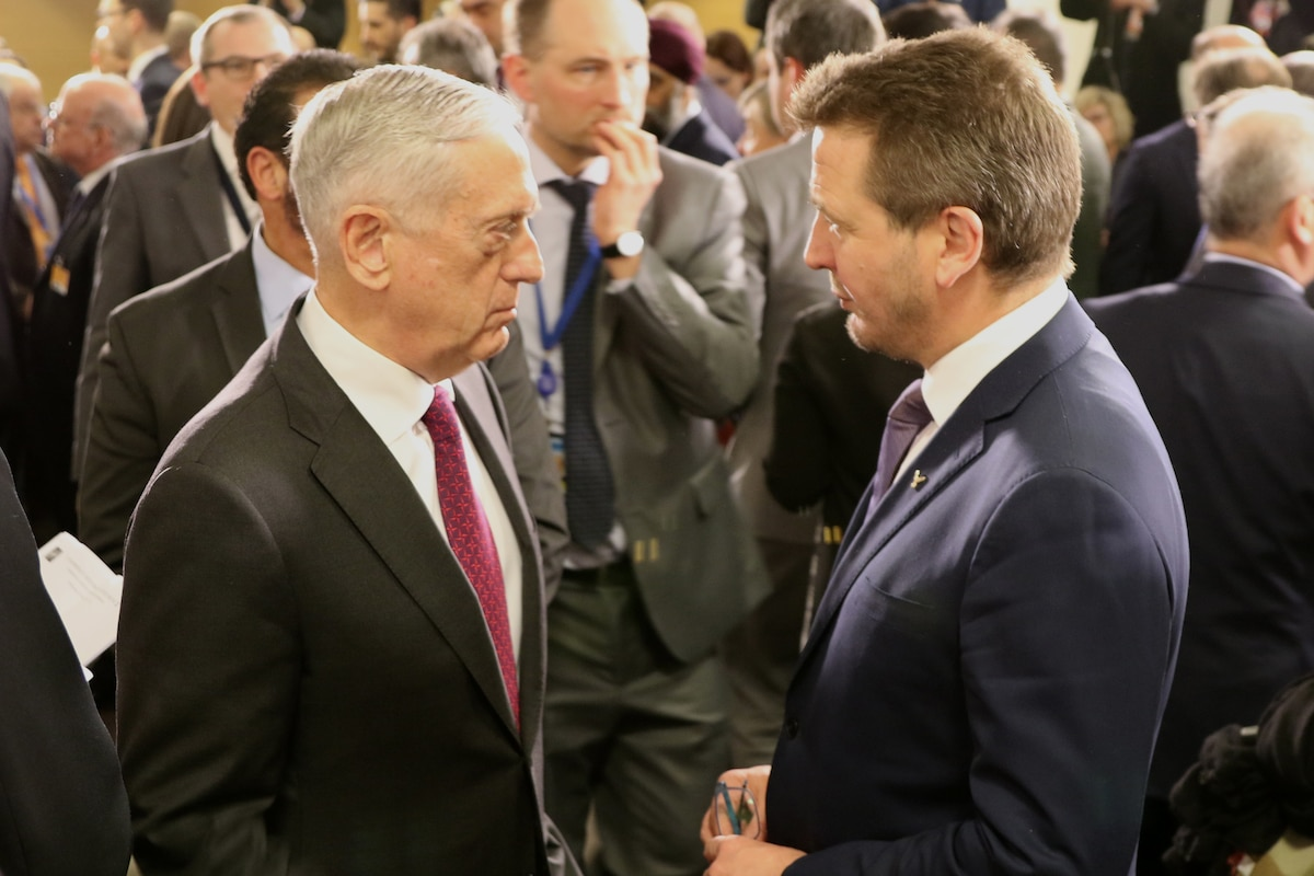 Defense Secretary James N. Mattis speaks with the Icelandic defense minister.