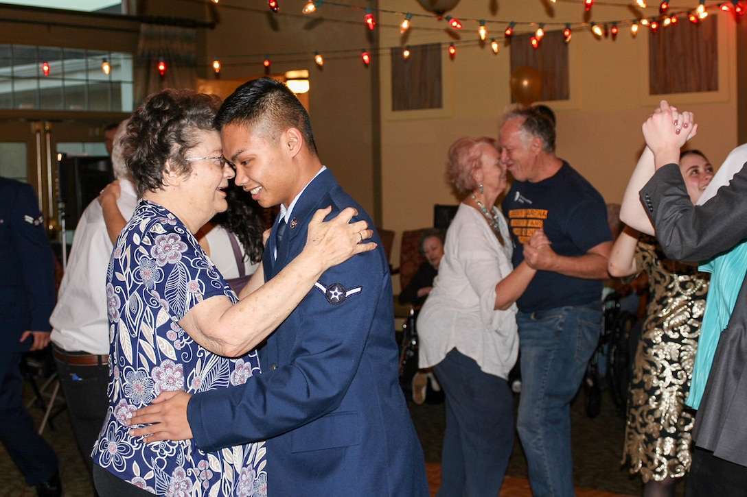 "Airman Christian Gran, 75th Medical Group, dances with a resident of Chancellor Gardens Senior Living Center in Clearfield Feb. 13 at the annual Valentines Dance. More than 60 residents attended and mingled with Team Hill guests. Staff members noted that the Team Hill Airmen are ""always the highlight of the event."" (U.S. Air Force photo by Jen Eaton)"