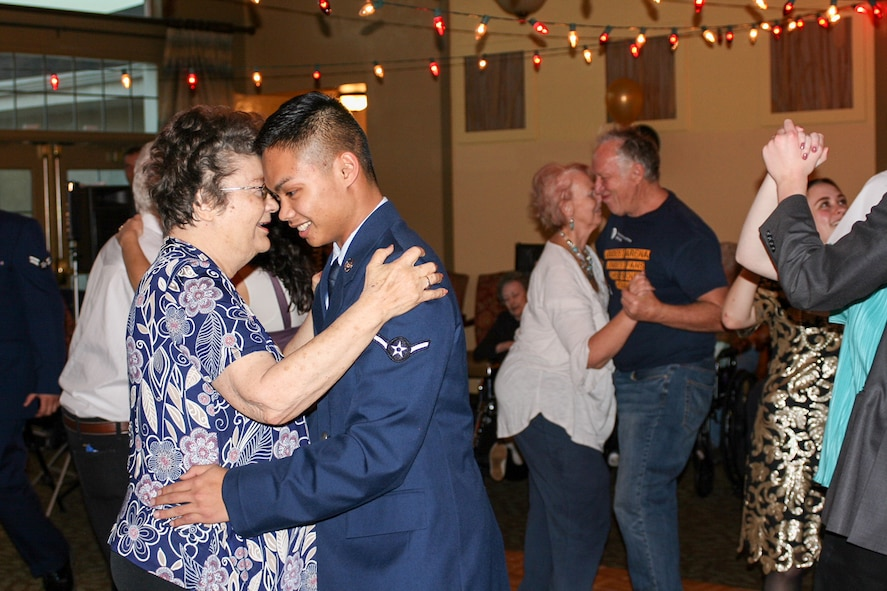 """Airman Christian Gran, 75th Medical Group, dances with a resident of Chancellor Gardens Senior Living Center in Clearfield Feb. 13 at the annual Valentines Dance. More than 60 residents attended and mingled with Team Hill guests. Staff members noted that the Team Hill Airmen are """"always the highlight of the event."""" (U.S. Air Force photo by Jen Eaton)"""