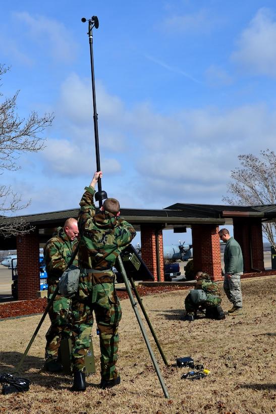 Airmen setting up equipment.