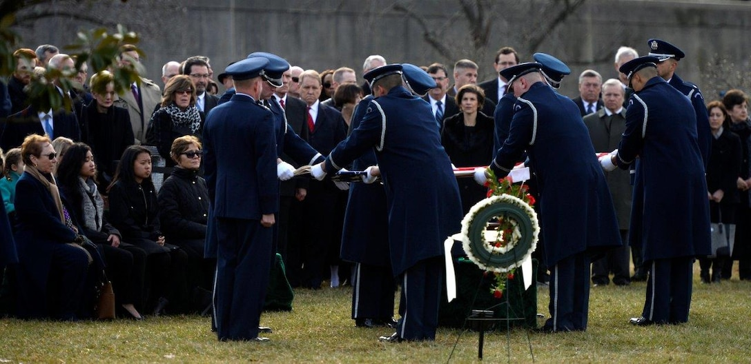 Ceremonial Guardsmen fold the American flag during the full honors funeral ceremony for retired Col. Leo Thorsness at Arlington National Cemetery, Arlington, Va., Feb. 14, 2018. Thorsness was a Vietnam prisoner of war and Medal of Honor recipient who served 23 years in the Air Force. (U.S. Air Force photo by Staff Sgt. Rusty Frank)