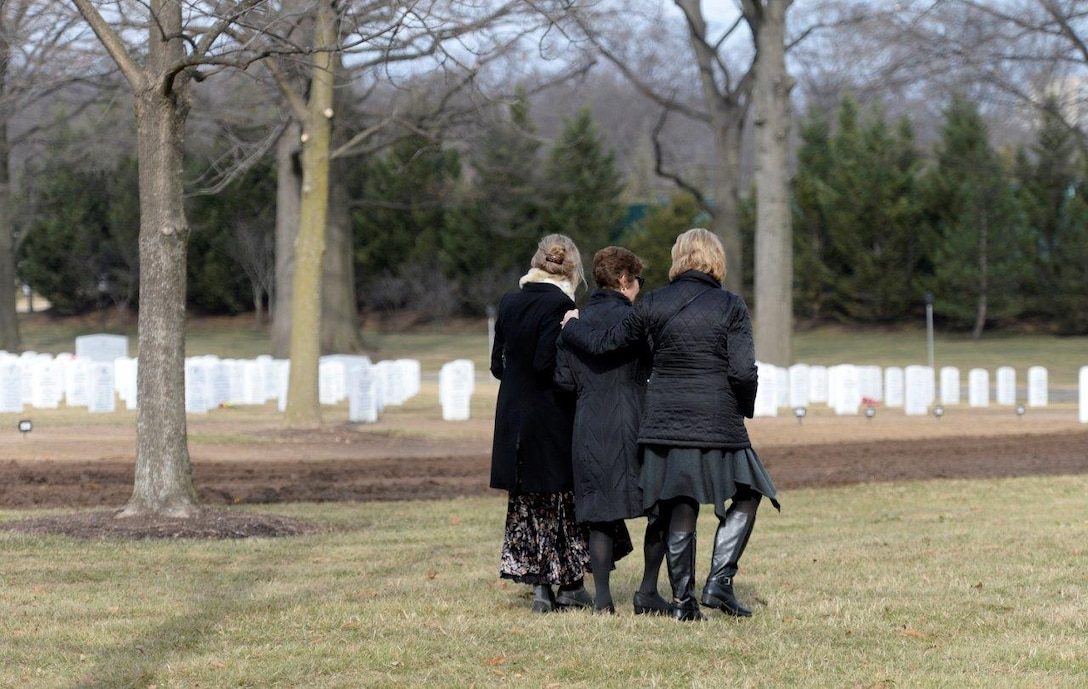 Family and friends pay their final respects to retired Col. Leo Thorsness following his full honors funeral at Arlington National Cemetery, Arlington, Va., Feb. 14, 2018. Thorsness received the Medal of Honor for his heroic actions during the Vietnam War. (U.S. Air Force photo by Staff Sgt. Rusty Frank)