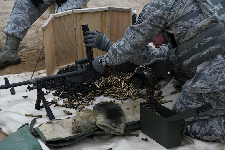 A U.S. Airman assigned to the 307th Security Forces Squadron loads ammunition into a M240B machine gun during annual weapons training at Fort Polk, Louisiana, Feb. 9, 2018.