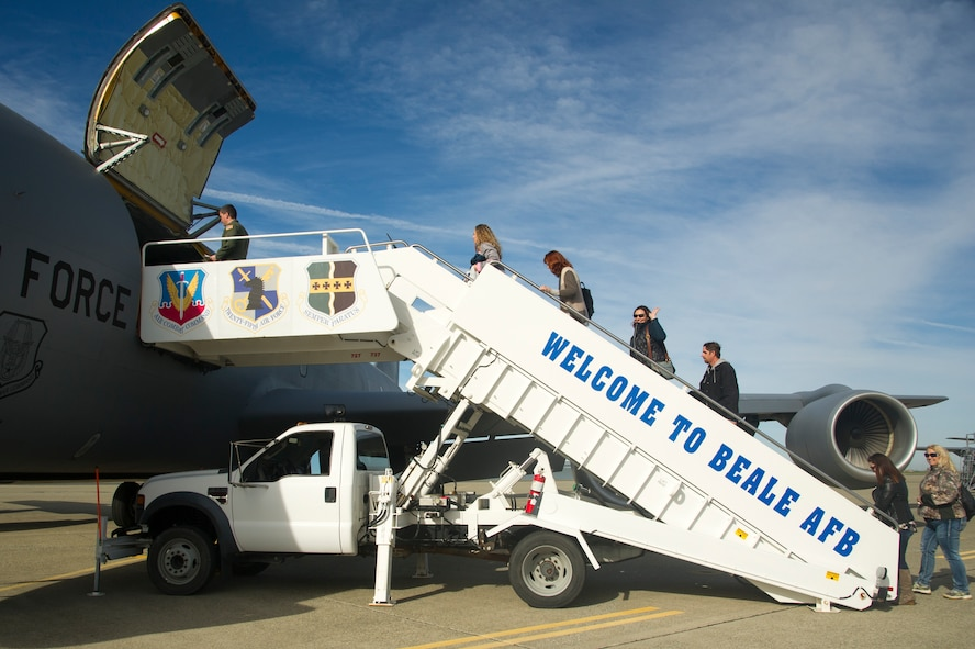 A group of 940th Air Refueling Wing spouses board a KC-135 Stratotanker Feb. 10 at Beale Air Force Base, California.