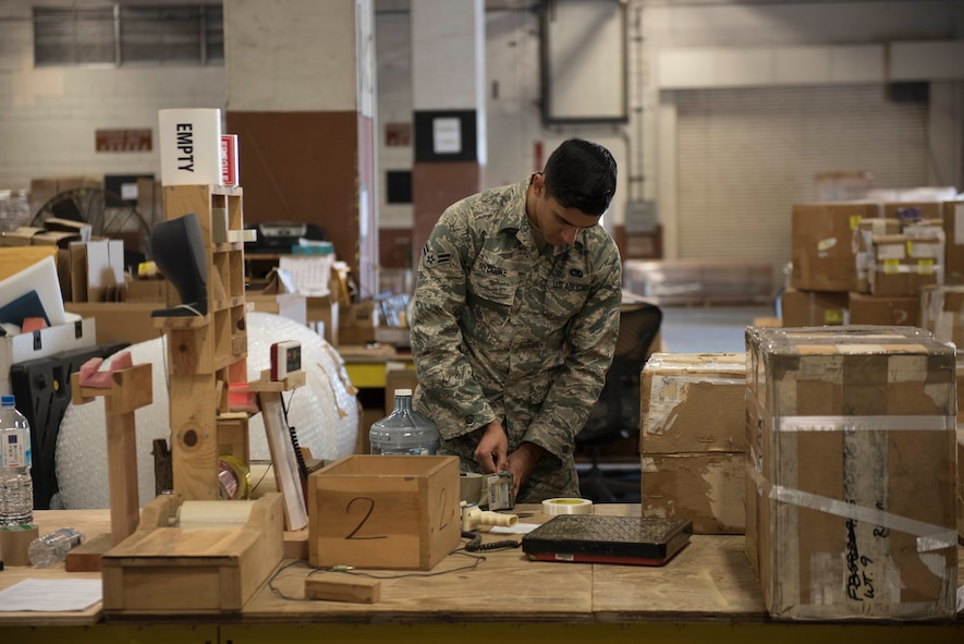 U.S. Air Force Airman 1st Class Casey Nydoske, 18th Logistics Readiness Squadron Traffic Management Office outbound specialist, prepares cargo for shipment, Feb. 14, 2018, at Kadena Air Base, Japan. The majority of items shipped through TMO are for repairs. (U.S. Force photo by Senior Airman Omari Bernard)
