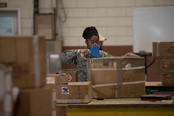 U.S. Air Force Staff Sgt. Bianca Mitchell, 18th Logistics Readiness Squadron Traffic Management Office outbound cargo movement traffic overseer, tapes up cargo for shipment to another installation, Feb. 14, 2018, at Kadena Air Base, Japan. TMO outbound supports more than just Kadena. A key part of their mission is to also support military installations and units around the globe. (U.S. Air Force photo by Senior Airman Omari Bernard)