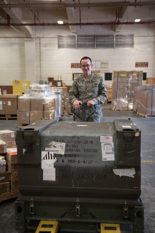 U.S. Air Force Senior Airman Michael Olson, 18th Logistics Readiness Squadron Traffic Management Office outbound specialist, transports cargo to a packing station Feb. 14, 2018, at Kadena Air Base, Japan. Before any cargo is shipped out, Airmen from TMO outbound verify the asset, inspect the item for damage, and then prepare the cargo for the appropriate transportation. (U.S. Air Force photo by Senior Airman Omari Bernard)
