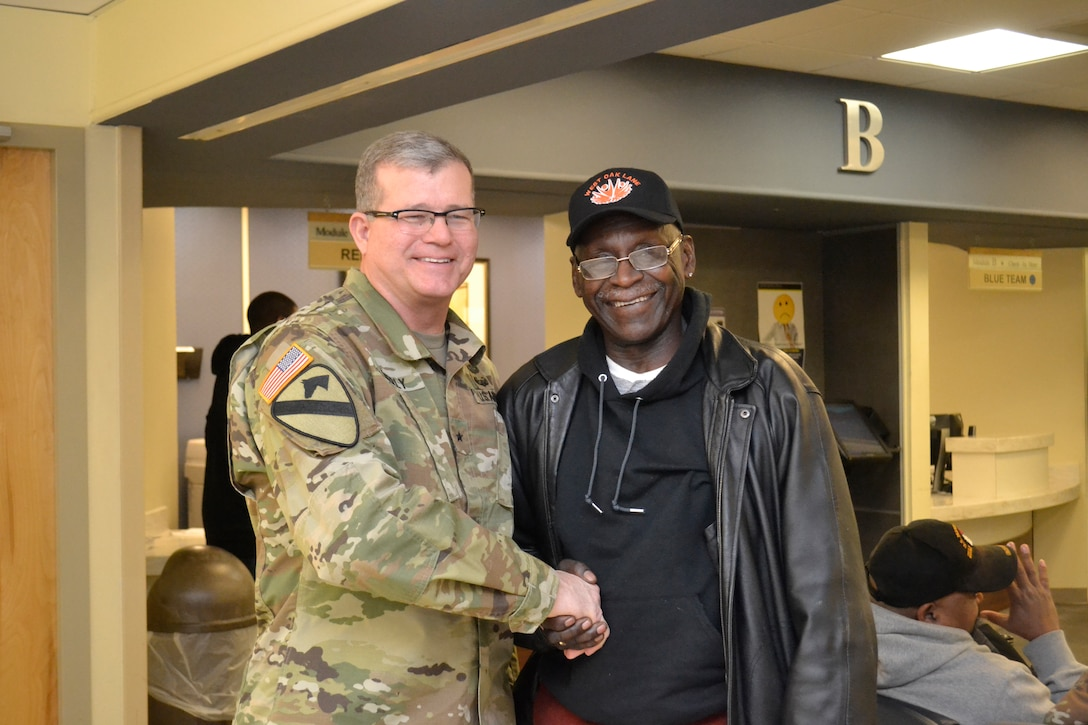 Army Brig. Gen. Mark Simerly, DLA Troop Support commander, shakes hands with a patient at the Corporal Michael J. Crescenz Veterans Affairs Medical Center Feb. 12, 2018 in Philadelphia.