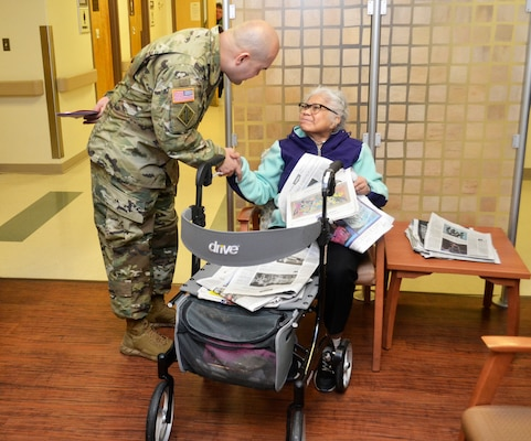 Army Master Sgt. Jose Moraga introduces himself to a patient waiting for care at the Corporal Michael J. Crescenz Veterans Affairs Medical Center, Feb. 12, 2018 in Philadelphia.