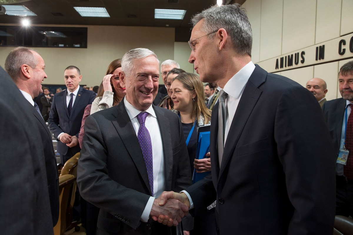 Defense Secretary James N. Mattis shakes hands with NATO Secretary General Jens Stoltenberg.