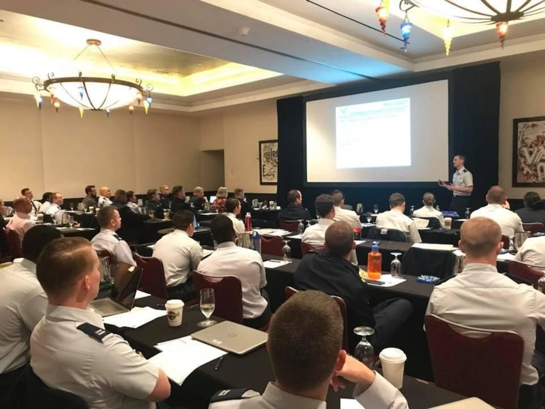 In December 2017, the 70th class of the Air Force Institute of Technology's Education with Industry Program gathered in Orlando, Florida, to share their company experiences with SAF/AQH, AFIT, and Air Force Personnel Center leadership as part of a Department of Defense-mandated mid-tour review.