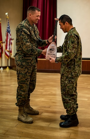 MARINE CORPS BASE CAMP PENDLETON, Calif - Col. Fridrik Fridriksson, commanding officer of the 11th Marine Expeditionary Unit, presents a oar as a gift to Col. Ryuki Toyota, the commanding officer of the Western Army Infantry Regiment, Japan Ground Self Defense Force during the closing ceremony of exercise Iron Fist 2018, Feb. 12. Iron Fist is an annual, bilateral training exercise where U.S. and Japanese service members train together and share techniques, tactics and procedures to improve their combined operational capabilities. (U.S. Marine Corps photo by Cpl. Jacob A. Farbo)
