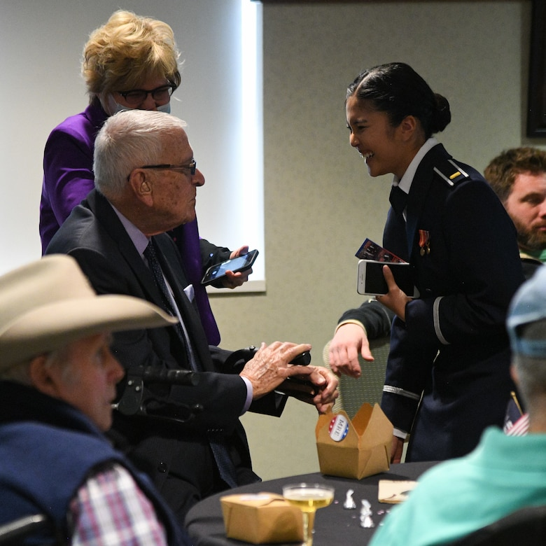 2nd Lt. Khaimook Grosshuesch speaks with three-war veteran Bob Ramos during a Valentine's Day dance held at the George E. Wahlen Veterans Home in Ogden, Utah, Feb. 14, 2018. (U.S. Air Force photo by R. Nial Bradshaw)
