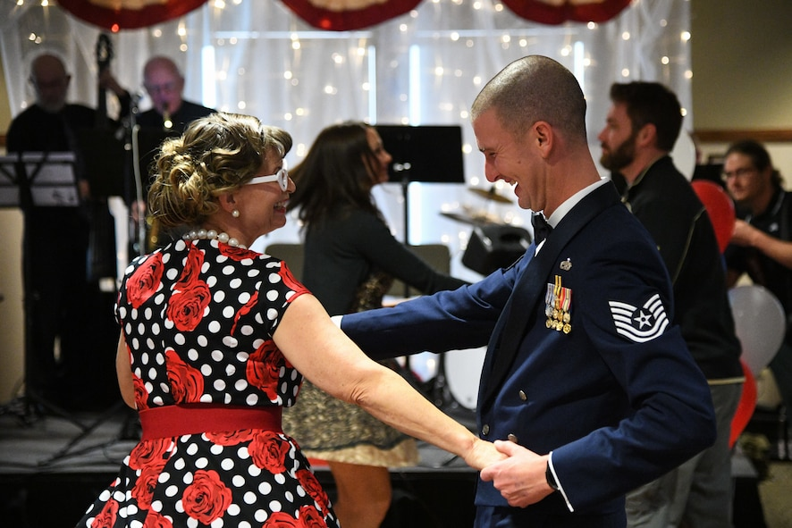 Tech. Sgt. Scott Patteson dances with Julie Hayes, facility recreation director, during a Valentine's Day dance held at the George E. Wahlen Veterans Home in Ogden, Utah, Feb. 14, 2018. (U.S. Air Force photo by R. Nial Bradshaw)