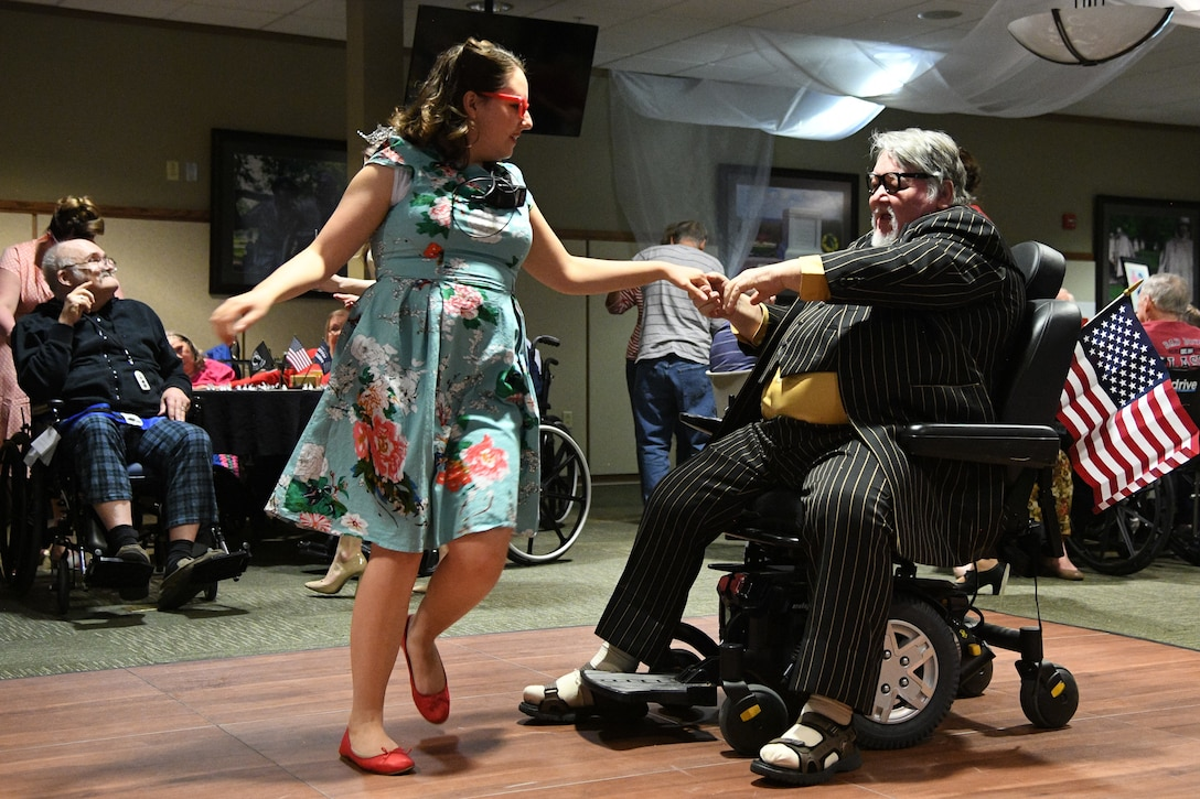 Veteran Roland Terry (right) dances with a staff member during a Valentine's Day dance held at the George E. Wahlen Veterans Home in Ogden, Utah, Feb. 14, 2018. (U.S. Air Force photo by R. Nial Bradshaw)