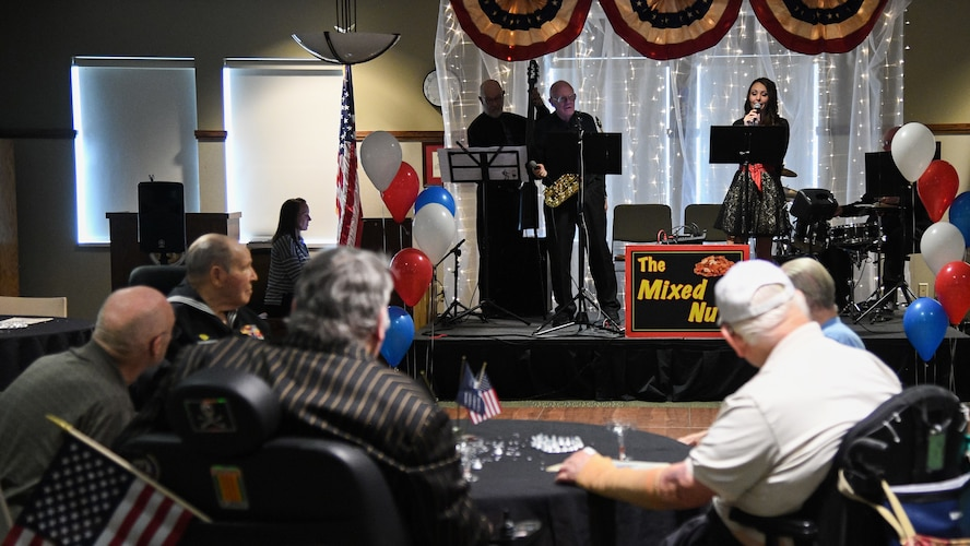 Veterans listen to a band play 40s and 50s music during a Valentine's Day dance held at the George E. Wahlen Veterans Home in Ogden, Utah, Feb. 14, 2018. (U.S. Air Force photo by R. Nial Bradshaw)