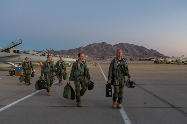 Number 6 Squadron aircrew walk across the flightline at Nellis Air Force Base, Nevada, after transitting from Australia for Exercise Red Flag 18-1. (Courtesy Photo)