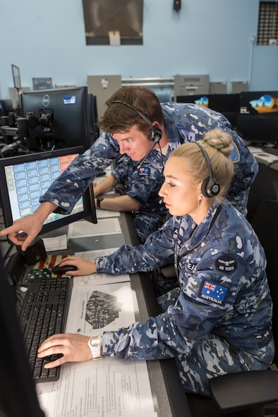 Flight Lieutenat Michael Pickering an Air Warfare Instructor and Flying Officer Stephanie Geaney a Air Battle Manager, monitors the airspace in the Control Reporting Centre at Nellis Air Base, Nevada, During Exercise Red Flag 18-1. (Courtesy Photo)