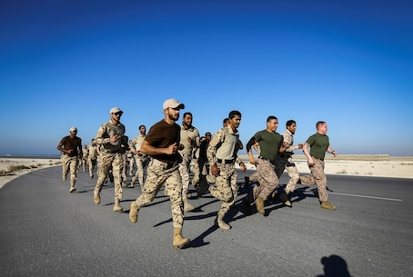 BAHRAIN (Jan. 14, 2018)  Fleet Anti-terrorism Security Team, Central Command, a subordinate command of Naval Amphibious Force, Task Force 51, 5th Marine Expeditionary Brigade – TF 51/5, and Bahrain Defense Force soldiers exercise together prior to conducting close quarters battle training. TF 51/5 staff frequently participates in subject matter expert exchange opportunities with partner nations to share expertise in respective fields and build upon partner nation capabilities in order to increase regional stability and improve interoperability. (U.S. Marine Corps photo by Sgt. Wesley Timm/Released)