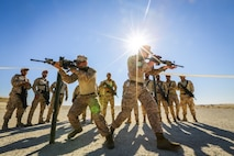 BAHRAIN (Jan. 14, 2018)  U.S. Marine Corps Cpl. Kaler Bishop (right) and Cpl. Matthew Elms (left), both riflemen attached to Fleet Anti-terrorism Security Team, Central Command, a subordinate command of Naval Amphibious Force, Task Force 51, 5th Marine Expeditionary Brigade – TF 51/5, demonstrate close quarters battle training to Bahrain Defense Force soldiers. TF 51/5 staff frequently participates in subject matter expert exchange opportunities with partner nations to share expertise in respective fields and build upon partner nation capabilities in order to increase regional stability and improve interoperability. (U.S. Marine Corps photo by Sgt. Wesley Timm/Released)