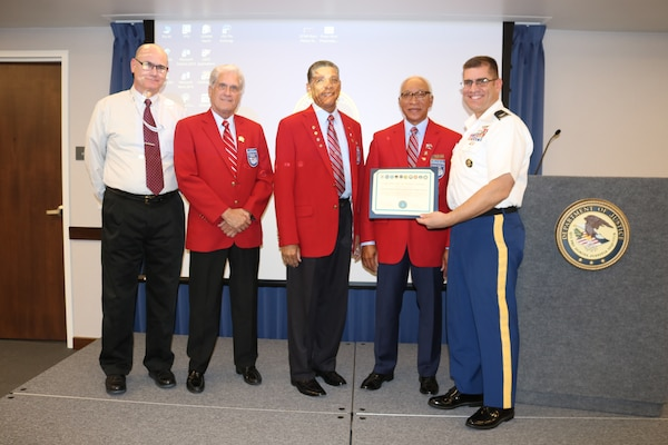 Wade McVey, Defense Contract Management Agency Phoenix deputy commander (left) and Army Col. Robert Miceli, commander (right), present a certificate of appreciation to three Tuskegee Airmen, David Toliver Sr., James Katra and Ted Vactor, at a Feb. 7 National African American History Month event at the agency's Phoenix office. The Tuskegee Airmen spoke about the history of black military pilots and ground crewmembers who served during World War II. (DCMA photo by Marissa Krings)
