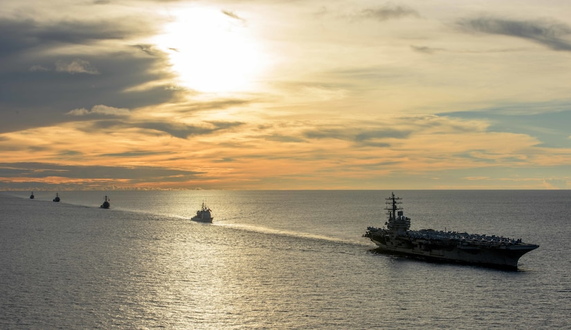 Ships sail in formation in the Persian Gulf.