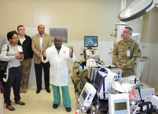 Army Col. Booker King explains the life-saving advances provided by the adult extracorporeal membrane oxygenation, or ECMO, program to federal participants in the Leadership Federal Executive Board during a tour of the San Antonio Military Medical Center Feb. 14 in San Antonio. The tour was part of a health care services day organized by the LFEB that included additional medical facilities to develop a better understanding of federal community. The LFEB is made up of 45 class members from various federal agencies across San Antonio who meet monthly to learn from key decision-makers in both the public and private sectors. SAMMC received national recognition in 2017 for its ECMO program, which is a heart-lung bypass system used in the treatment of affected organs. King is a surgeon assigned to SAMMC.